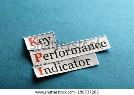 key performance indicator, KPI  on blue paper - stock photo