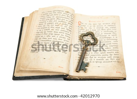 key placed on an 18st century vintage book, isolated on white - stock photo