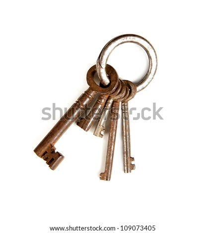 Key-ring isolated on white with rusty keys in different sizes - stock photo