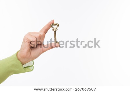 Key to new appartment. Hand hold old key isolated on white - stock photo