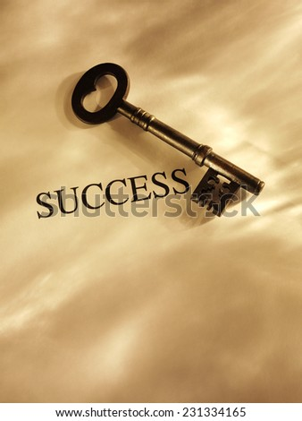 Key to Success on a Paper Background with Gold Lighting