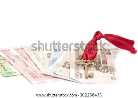 Key to success On International Money isolated - stock photo