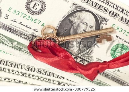 Key to success on one dollar banknotes isolated - stock photo