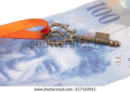 Key To Success With Red Bow on Swiss Franc note - stock photo