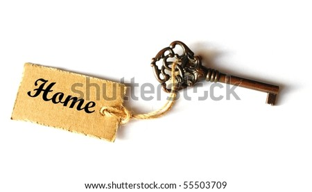 key to your new home showing real estate concept - stock photo