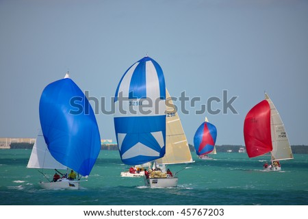 KEY WEST, FL - JAN 21: PHRF sailboats go downwind with spinnakers during Key West Race Week on January 21, 2009. - stock photo