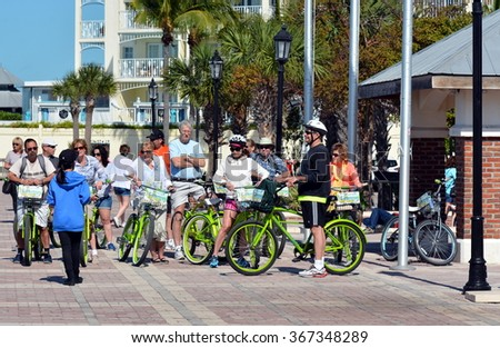KEY WEST, FL.-JANUARY 24: Tourists in Key West, Florida, prepare to take a Key Lime Bicycle Tour on January 24, 2016.  These tours take tourists around the island to famous and historical places. - stock photo