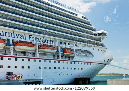 KEY WEST, FL - JULY 11:  Passengers boarding Carnival's Freedom ship after a day in Key West on July 11, 2011. In 1984, the city improved Mallory Dock, making it a full cruise ship docking facility. - stock photo