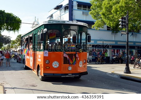 KEY WEST, FL-JUNE 12: A trolley in the Key West Gay Pride parade carrying a memorial banner honoring those killed in the terror attack at the nightclub in Orlando, Fl. on Sunday, June 12, 2016. - stock photo
