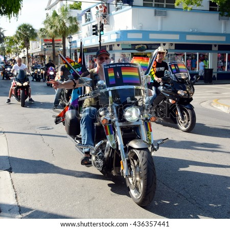 KEY WEST, FL-JUNE 12: Motorcycle riders take part in the Key West Gay Pride parade  honoring those killed in the terror attack at the nightclub in Orlando, Fl. on Sunday, June 12, 2016. - stock photo