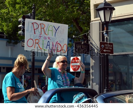 KEY WEST, FL-JUNE 12: People marching in the Key West Gay Pride parade carry a memorial banner honoring those killed in the terror attack at the nightclub in Orlando, Fl. on Sunday, June 12, 2016.
