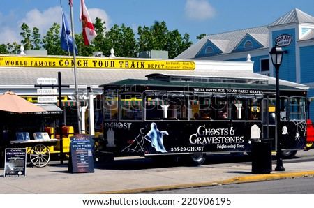 """KEY WEST, FL.-OCTOBER 1:  A """"Ghost and Gravestones"""" trolley awaits riders in Key West, Fl. on October 1, 2014.  Tourists are taken on a tour of Key West's haunted past and  scary gravestones. - stock photo"""