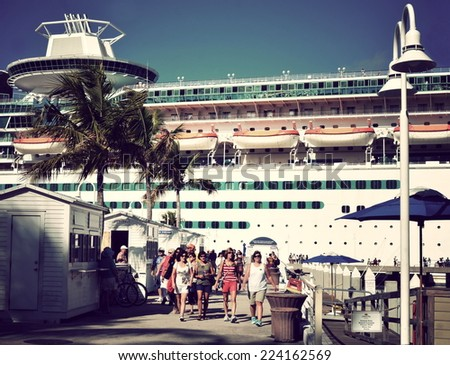 "KEY WEST, FL.-OCTOBER 16:  Tourists from the Royal Caribbean cruise ship ""Majesty of the Seas"" arrive in Key West on October 16, 2014, in this instagram style filtered image for vintage look. - stock photo"