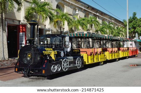 KEY WEST, Fl.-SEPTEMBER 3:  A Key West Conch Tour Train, a popular tourist attraction in Key West, waits to take the next group of visitors on a narrated tour of the island on September 3, 2014.  - stock photo
