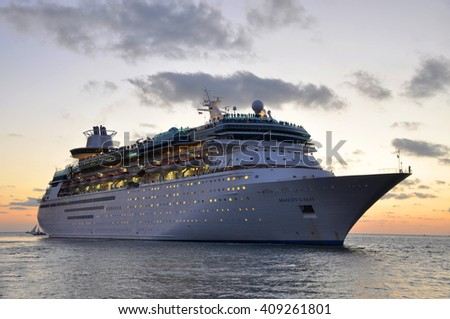 KEY WEST, FL, USA - DEC 20: Majesty of the Seas docked at sunset on December 20th, 2012 in Key West, Florida, USA. - stock photo