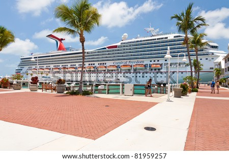 KEY WEST, FLA - JULY 11:  Carnival Freedom arrives in Key West, Florida on July 11, 2011. Over 660,000 cruise ship passengers visit Key West every year to see historic homes, shops and unique bars. - stock photo