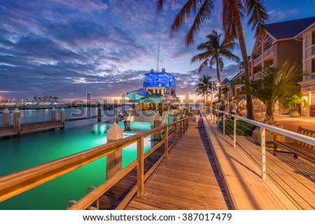 KEY WEST, FLORIDA - JANUARY 12, 2016: Yacht anchored at night in city port. Key West is a famous tourist attraction in Florida. - stock photo