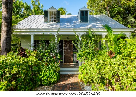 KEY WEST, FLORIDA USA - JUNE 26, 2014: The beautifully restored 1840 vintage John Curry House in the residential Historic District of Key West.