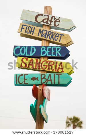 Key West guideposts gives directions for fun and drinks. - stock photo