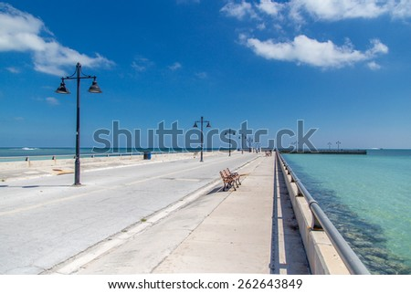 Key West Pier stretches out into the ocean Landscape - stock photo