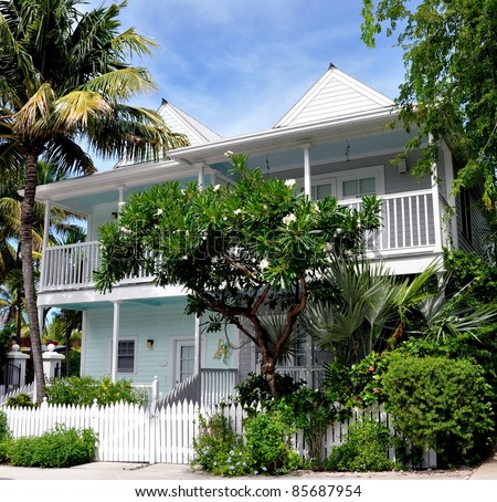 Key West Style Beach House Architecture With tropical Foliage - stock photo