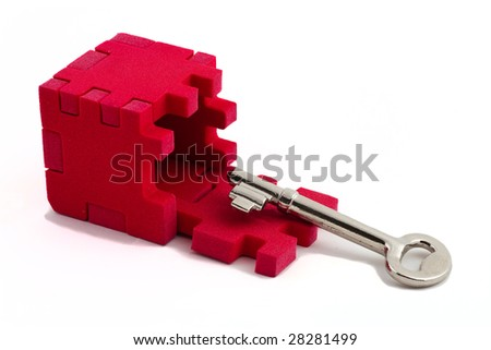 Key with a cube puzzle. Concept of solving problems. Isolated on white background. - stock photo