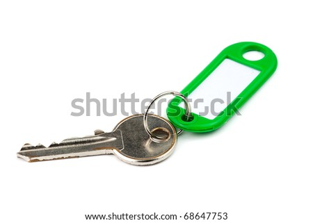 key with green nameplate - stock photo