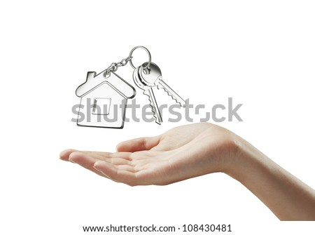 key with  key chain on hand on white background - stock photo
