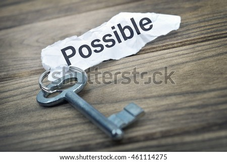 Key with message possible on wooden table