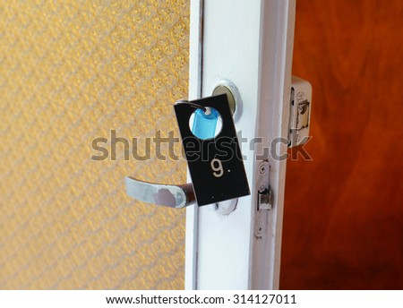 Key with number six plate on wooden door