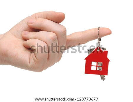 key with red home shape on chain in hand on white background - stock photo