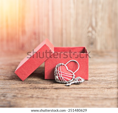 Key with the heart and open gift box as a symbol of love valentin es day background;lighting effect vintage style - stock photo