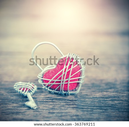 Key with the heart as a symbol of love,valentin background,love concept,vintage process style - stock photo