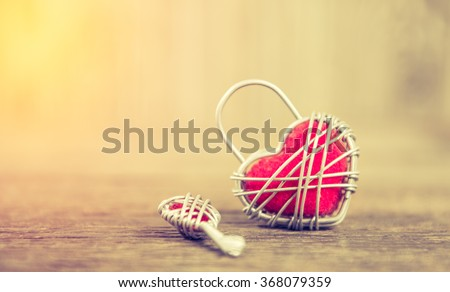 Key with the heart as a symbol of love ,valentin es day background;lighting effect vintage style - stock photo