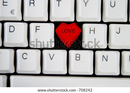 Key with the word LOVE on it, on a computer keyboard