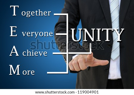 Key word of Unity and Team with Business Hand Pointing - stock photo