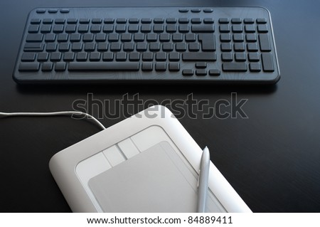Keyboard and graphic tablet closeup