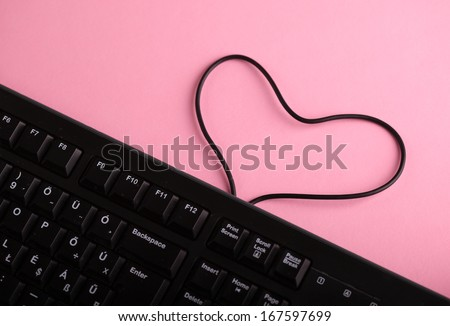 Keyboard and heart shaped cable symbol love on internet - stock photo