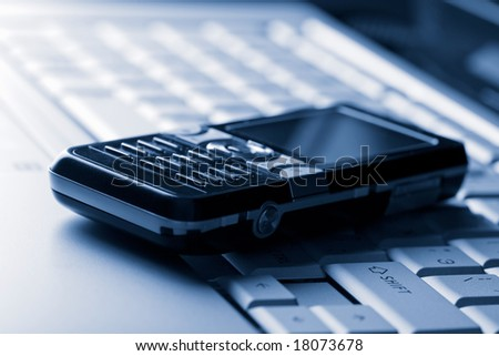 keyboard and mobile phone background - stock photo