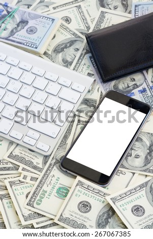 keyboard and modern phone  with copy space on screen on money background - stock photo