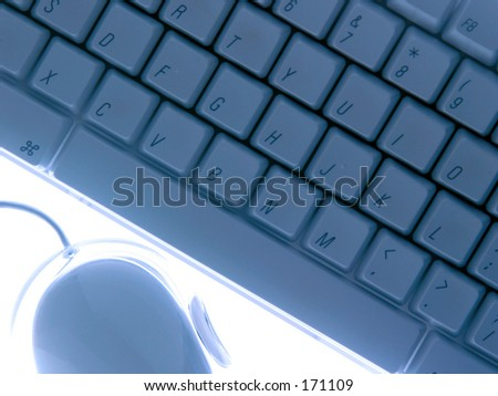 Keyboard and mouse in blue light on white