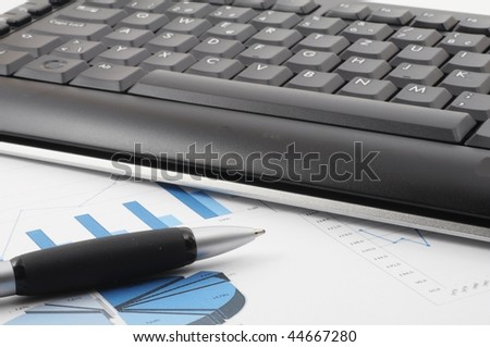 keyboard and paper on a desk in the office