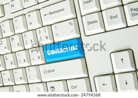 Keyboard  blue key Contact us - stock photo