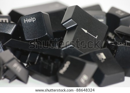 "Keyboard broken in pieces over a white background, focused in the ""Help"" key. - stock photo"