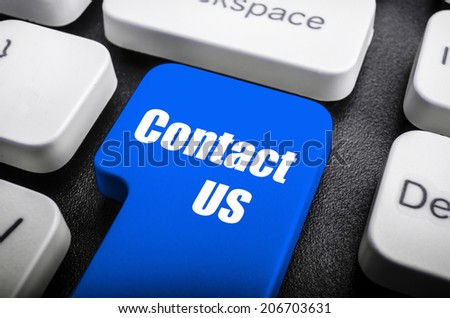 Keyboard button Contact us colored in red - stock photo