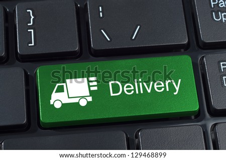 Keyboard button with truck icon and text delivery Internet concept. - stock photo