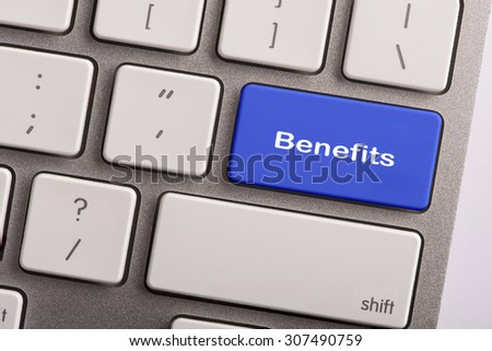 keyboard button with word benefits - stock photo