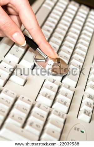 Keyboard examing famale hand. - stock photo