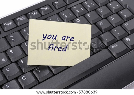 "keyboard in office with message ""you are fired"" - stock photo"