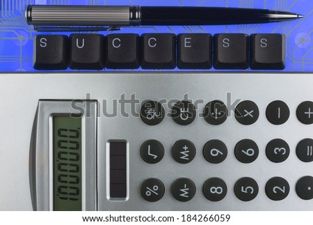 Keyboard keys laid out the word success on a blue  background